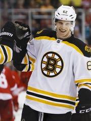 Boston Bruins defenseman Zach Trotman receives congratulations