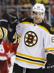Boston Bruins defenseman Zach Trotman receives congratulations