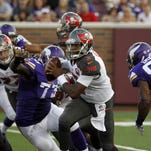 Tampa Bay Buccaneers quarterback Jameis Winston (3) scrambles against the Minnesota Vikings during the first half of a preseason NFL game Saturday at TCF Bank Stadium in Minneapolis.