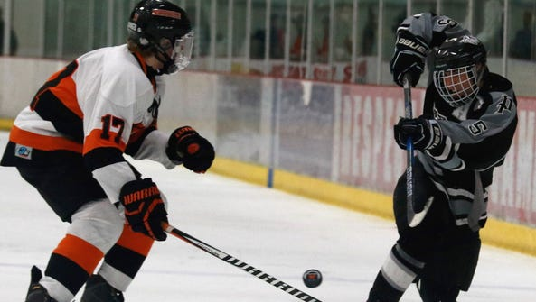 Plymouth's Colton Burke (right) fires a shot as Northville's