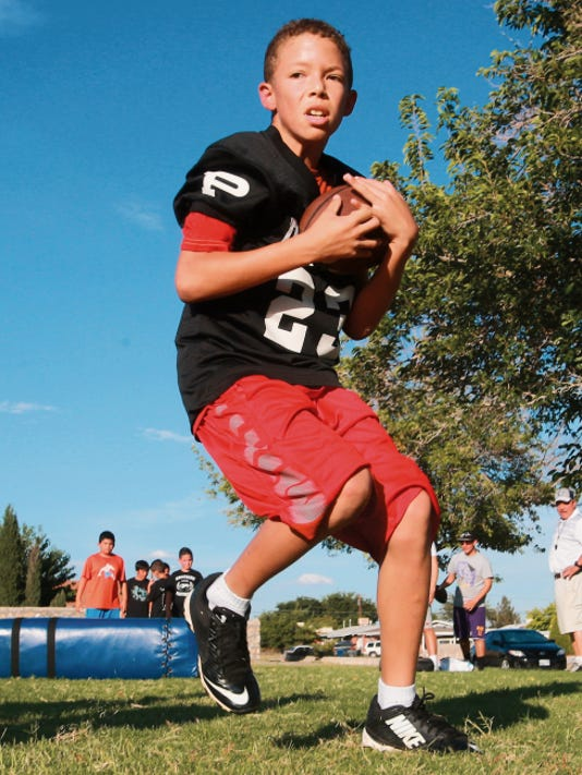 Eastside Panthers player Gilbert Hernandez heads up the field after pulling in a pass during a recent workout.