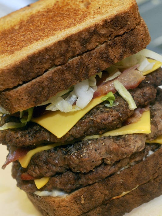 """The """"Route 30 Burger"""" is made up of grilled cheese sandwiches, burger(s), more cheese and bacon, with the option of condiments and other assorted meat."""