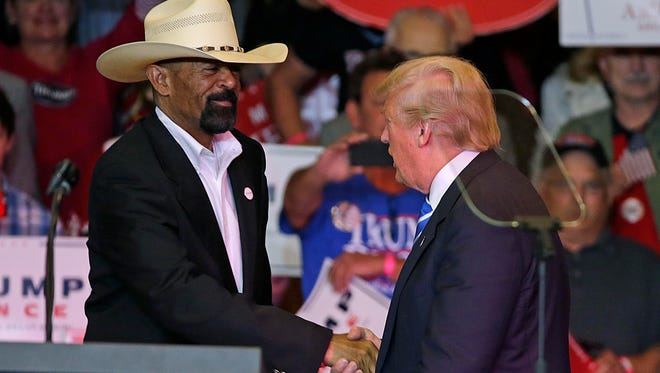Milwaukee County Sheriff David A. Clarke Jr. greets President Donald Trump during a Waukesha appearance in September, before the election.