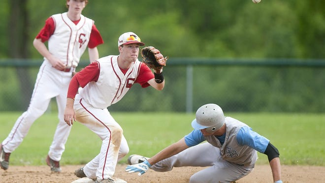 Champlain Valley shortstop Will Potter, center, receives the throw at second base as South Burlington's Connor Bradley slides in safe during the sixth inning of Wednesday's Division I semifinal in Hinesburg.
