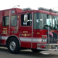 Firefighters battle large house fire early Friday