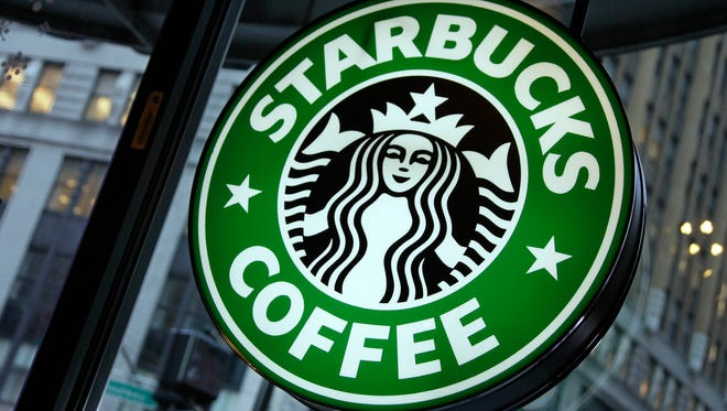 Starbucks says it will eliminate plastic straws at its store by 2020.  (AP Photo/Richard Drew, File)