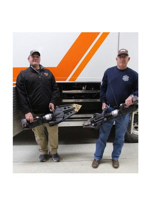 Firefighter Scott Krzmarzick (left) and Sleepy Eye Fire Department Chief Ron Zinniel display the new rescue equipment partially funded by proceeds from the 2018 and 2019 fall Fire Department benefits.