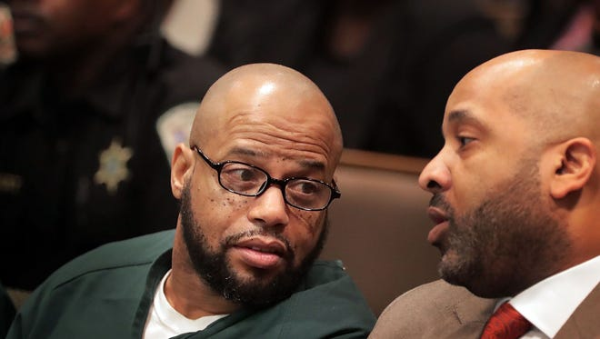 Billy Turner, left, talks with his lawyer John Keith Perry before a hearing in Judge Lee Coffee's courtroom on charges in the slaying of former NBA player Lorenzen Wright. Turner pleaded not guilty.