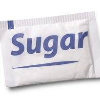 Small sugar packet isolated on white