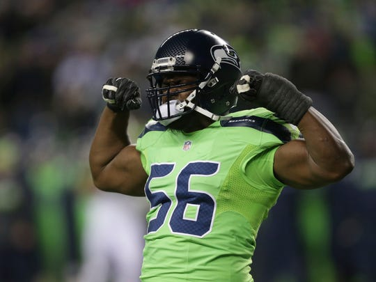 Seattle Seahawks defensive end Cliff Avril reacts after he sacked Los Angeles Rams quarterback Jared Goff in the second half Dec. 15  in Seattle.