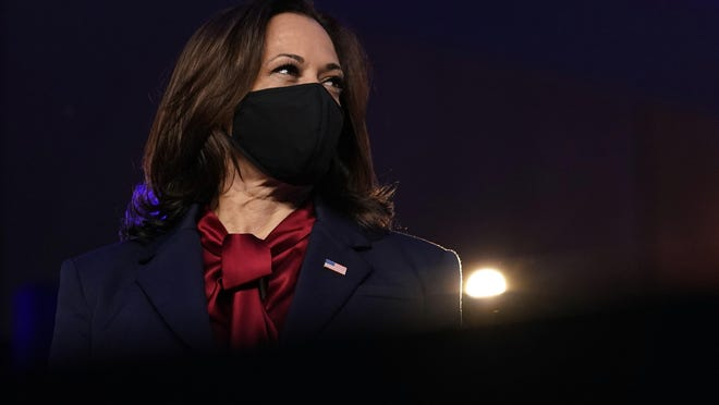 Democratic vice presidential candidate Sen. Kamala Harris, D-Calif., listens as Democratic presidential candidate former Vice President Joe Biden speaks Friday, Nov. 6, 2020, in Wilmington, Del.