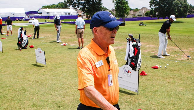 In this 2014 photo, FESJC tournament director Phil Cannon checks in with players on the practice range.