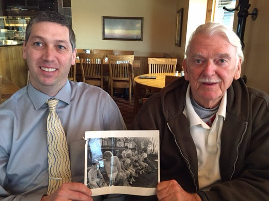 Larry Luebbers Jr., left, and his father show a photo of their re-created Crosley Field in the 1970s in Union.