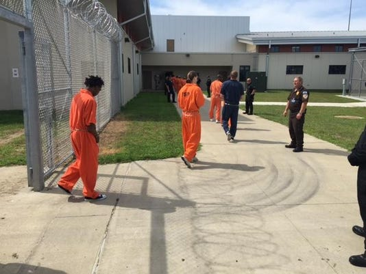 Inmates arriving at new state prison