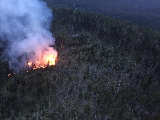 The Sucker Creek fire is actively burning away from the town of Lincoln, and into the 2003 Snow Talon fire area.