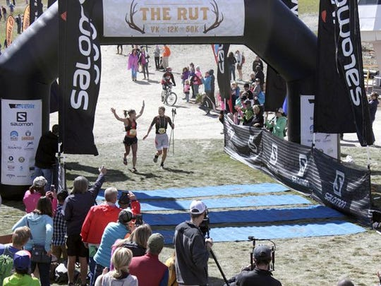 Emelie Forsberg crosses the finish line at the Rut Race at Big Sky Resort, winning the 50K race in 2014.