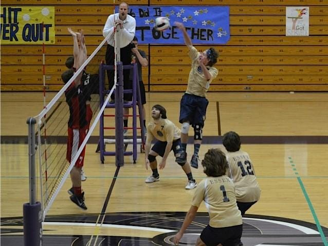 Essex senior Andrew Wagner returns the ball during the volleyball finals Saturday.