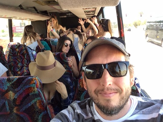 Desert Sun columnist Shad Powers takes a selfie with his shuttle bus mates on the way to Coachella.
