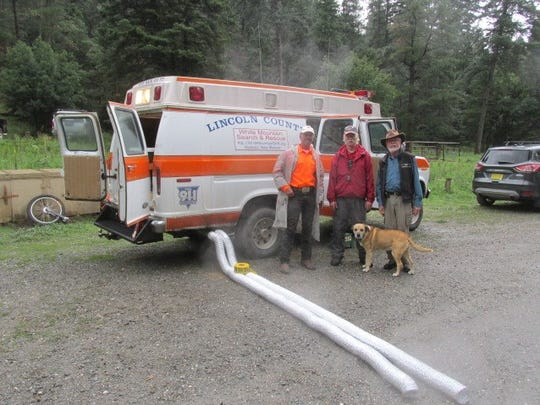 Members of White Mountain Search and Rescue participating were from left, Matthew Midgett; Bill McGeachy, base camp officer Tony Davis and Lulu, Midgett's search companion.