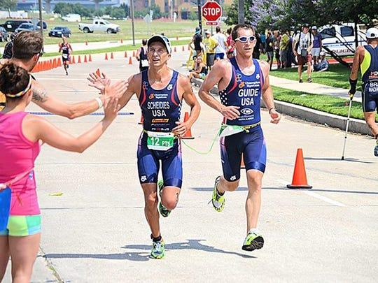 Aaron Scheidies (left) and guide Ben Collins compete