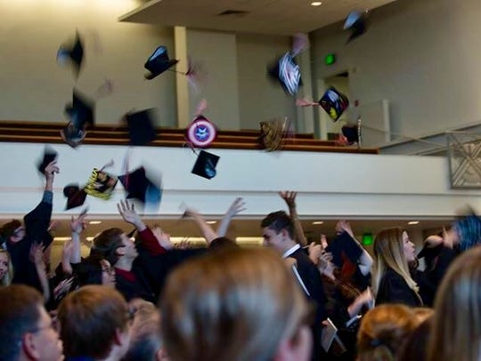 Arizona School for the Arts students toss their caps