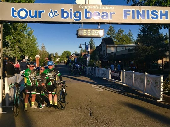 Gerardo Gomez (left) and Eduardo Gomez took their 125-mile, 12 thousand-foot Tour de Big Bear climb in California on Aug. 5, wearing team jerseys adorned with the handprints and signatures of Driscoll Children's Hospital patients who inspire them.