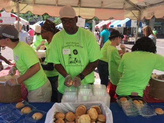 Aaron Bailey, center, volunteers at the 2017 Christ Church Cathedral Women's Strawberry Festival.