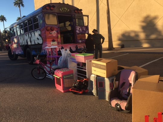 Skaters at Chandler's Ice Den filled the Let's Be Better Humans bus with toys.