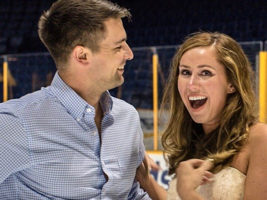 Holly Hammonds and R.J. Edwards at Bridgestone Arena July 1, 2017, just after he proposed to her on the ice. The two met at the arena two years earlier at a Kenny Chesney concert