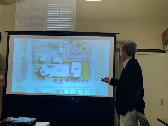 Jack Faber with Hafer, an architectural firm, shows plans for the library expansion.