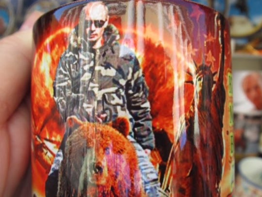 A Vladimir Putin coffee mug being sold outside Church of Our Savior on Spilled Blood in Saint Petersburg, Russia.