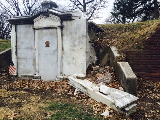 White marble has fallen from the front of former Gov. Samuel Merrill's mausoleum at Woodland Cemetery in Des Moines.