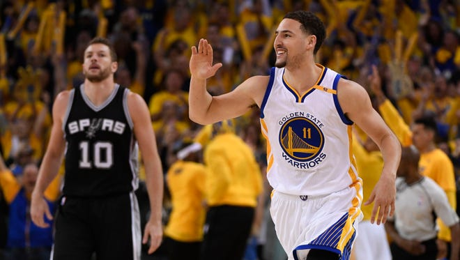 Klay Thompson celebrates in front of San Antonio Spurs forward David Lee during the third quarter in Game 1 of the Western Conference finals.