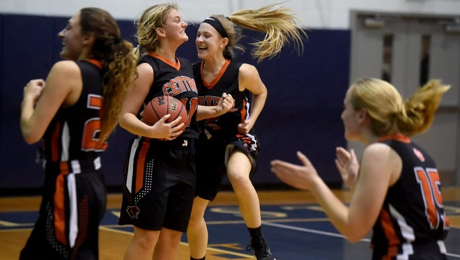 Central York's Nikson Valencik celebrates with her teammates after Tuesday's 51-44 win over Dallastown.