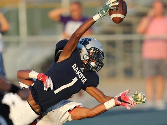 Macomb Dakota's Jalen Hall catches a touchdown pass