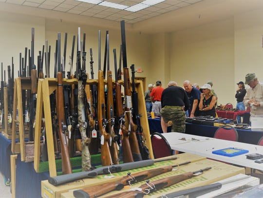 A huge variety of guns--cowboy guns to pistols, rifles,