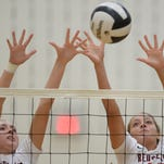 Richmond's Megan Crass, left, and Paityn Farris jump to block Tuesday, Sept. 1, 2015 during a volleyball match against Northeastern in Fountain City.