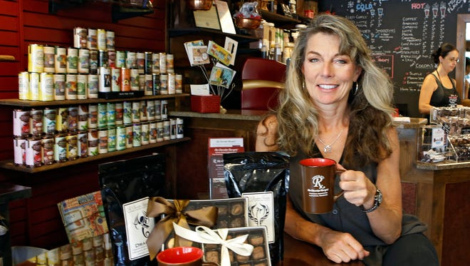 Julie Pech poses in her chocolate and coffee shop, The Chocolate Therapist, in Littleton, Colo. When a coffee and beer bar opened up two doors away from Pech's shop, she took a positive approach to the new competition, focusing on her store's strengths.