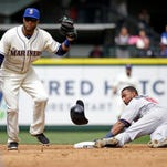 Seattle Mariners second baseman Robinson Cano, left, puts a tag on Minnesota Twins' Eduardo Nunez on a stolen base attempt at second base in the third inning of a baseball game Sunday, April 26, 2015, in Seattle. Nunez was out on the play.