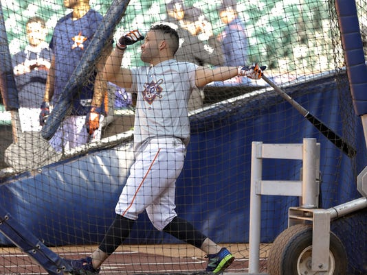 Houston Astros' Jose Altuve takes batting practice before a baseball game against the Texas Rangers, Sunday, April 15, 2018, in Houston. Both teams wore No. 42 in honor of Jackie Robinson Day. (AP Photo/Michael Wyke)