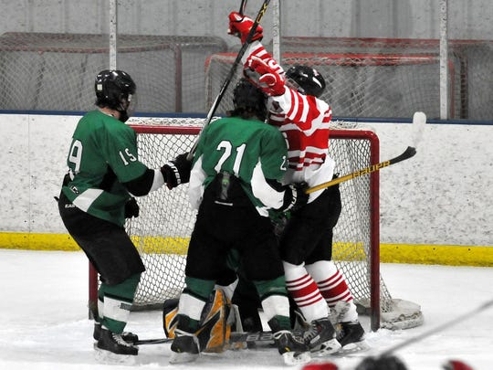 Daniel Mitch of the Pacelli co-op celebrates his power-play goal in the second period and the Cardinals went on to beat Rhinelander/Three Lakes 1-0 in a WIAA regional opener at Ice Hawks Arena on Tuesday night.