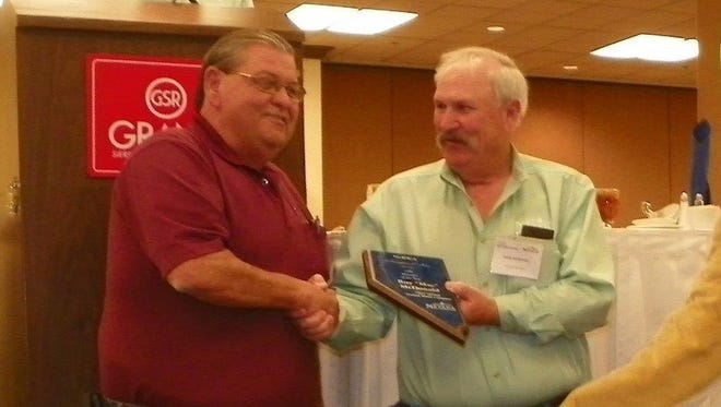 Retiring Silver Springs Mutual Water Co. general manager Roy McDonald accepts the award as General Manager of the Year.