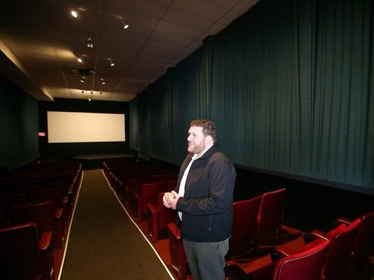 Dragonfly Cinema owner Nick Taylor is shown at the movie theater in Port Orchard.