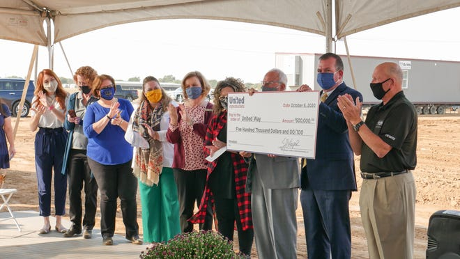 The United Family presents a $500,000 donation for United Way agencies in the area, which was raised through the Jackie Pierce Charity Classic golf tournament.