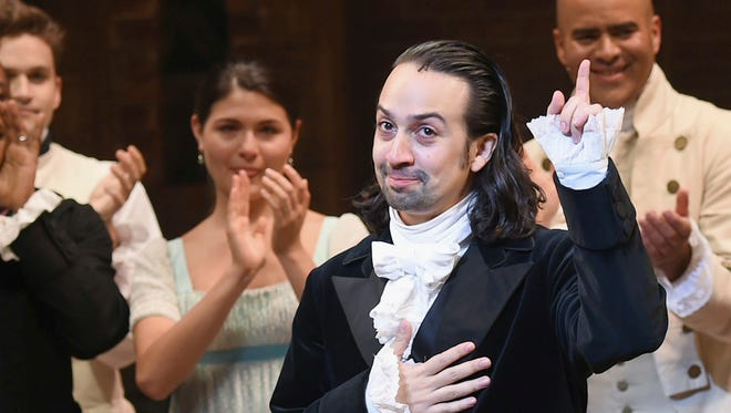 """""""Hamilton"""" creator Lin-Manuel Miranda, foreground, gestures during his final performance curtain call in New York."""