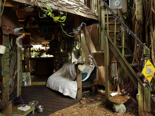 This Monday, Sept. 19, 2016 photo shows part of the treehouse where Shawnee Chasser lives in Miami. Chasser says she hates the oppressive feeling of walls and air conditioning, loves the open breeze and relishes the connection to nature in lush, tropical surroundings. (AP Photo/Lynne Sladky)