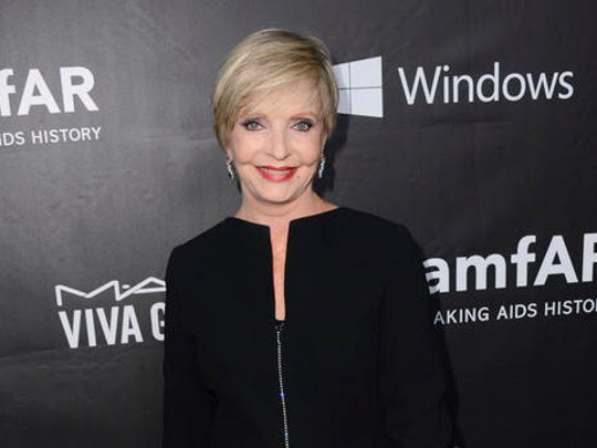 "FILE - In this Oct. 29, 2014 file photo, Florence Henderson arrives at the 2014 amfAR Inspiration Gala at Milk Studios in Los Angeles. Henderson, the wholesome actress who went from Broadway star to television icon when she became Carol Brady, the ever-cheerful mom residing over ""The Brady Bunch,"" has died at age 82. She died surrounded by family and friends, her manager, Kayla Pressman, said in a statement late Thursday, Nov. 24, 2016."