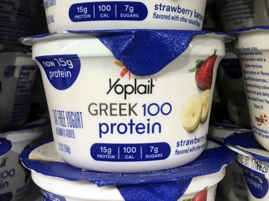 This Thursday, Feb. 23, 2017, photo shows Yoplait Greek yogurt on display at a supermarket in Port Chester, N.Y. A lawsuit in 2012 said Yoplait Greek was misleadingly marketed because it contained an ingredient not listed in the federal standard of identity for yogurt. The suit was dismissed. General Mills notes that it has since made recipe changes and that Yoplait Greek no longer includes the ingredient that prompted the lawsuit.