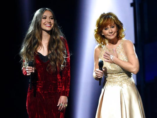 """Lauren Daigle, left, and Reba McEntire perform """"Back to God"""" at the 52nd annual Academy of Country Music Awards at the T-Mobile Arena on Sunday, April 2, 2017, in Las Vegas."""
