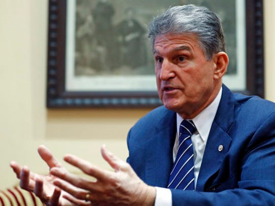 FILE - In this Feb. 1, 2017, file photo, Sen. Joe Manchin, D-W.Va. speaks during an Associated Press interview in his office on Capitol Hill in Washington. It's a rare and momentous decision, one by one, seated at desks centuries old, senators will stand and cast their votes for a Supreme Court nominee. It's a difficult political call in the modern era, especially for the 10 Democrats facing tough re-election next year in states that President Donald Trump won.